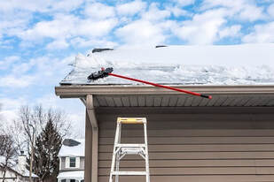 Clear Ice Dams from Gutters in Denver